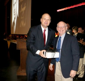 """Carrollton High School Principal Dr Mark Albertus, left, presents a gift to the 2014 recipient of the Carrollton High School Distinguished Alumni Award to Dr. Richard M. """"Dick"""" Ingle. The presentation was made April 24 at the CHS honors program."""