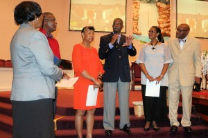 Living Well with Chronic Disease instructor Jarvis Daniel addresses the congregation of First Baptist Church of Carrollton. Living Well graduates Nettie Geter, Emanuel Geter and Elerie Daniel were presented certificates of completion by Pastor Bradley Bell and his wife, Lorie.