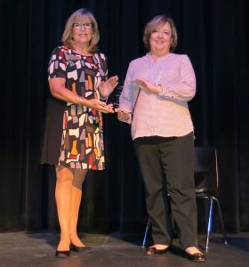 Dr. Melanie McClellan, right, accepts 2016 Woman of the Year award from Paula Gillispie, the 2015 award winner.
